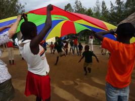Fun and games with the parachute at Mier Pamoja Care Centre