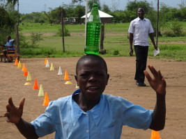School games day. Could you run 50 metres with a full glass bottle of water on your head? (No hands!)