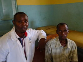 Stephen (left) with one of his patients